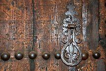 Old door with knocker  by Arie Koene