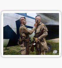 Filthy Thirteen member Clarence Ware applies war paint to Charles Plaudo. England, 31 December 1943. Sticker