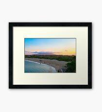 Family leaves the beach Framed Print