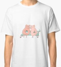 Couple of cute pigs sitting on a bench Classic T-Shirt