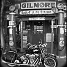 """""""Harley At The Filling Station"""" by Gail Jones"""
