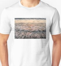 Bubbles in Motion - Whimsical Patterns in the Surf at Sunrise T-Shirt