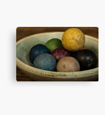 Clay Marbles in a small bowl Canvas Print