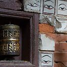 Bell and buddha eyes in a buddhist temple by Clara Go (missatgerebut)