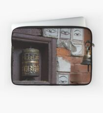 Bell and buddha eyes in a buddhist temple Laptop Sleeve