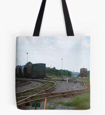 Train yard on a hazy day Tote Bag