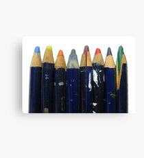 Old colored art pencils in a row, drawing, artist materials Canvas Print