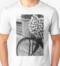 Close up on street bicycle with basket of flowers T-Shirt