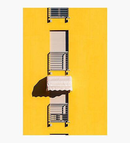 Window with sunshade on a yellow wall Photographic Print