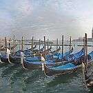 Gondolals in front of San Giorgio Maggiore Venice Italy by John Keates