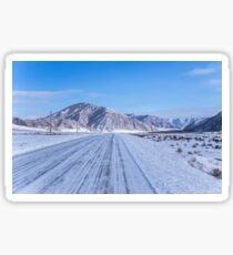 Winter travel on Mountain road Sticker