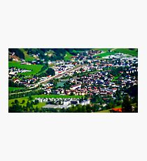 Tilt-shift aerial view of little austrian city in the valley, Austria, summer Photographic Print
