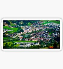 Tilt-shift aerial view of little austrian city in the valley, Austria, summer Sticker