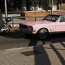 The motorist and the girl in the pink Mustang by Esther  Moliné