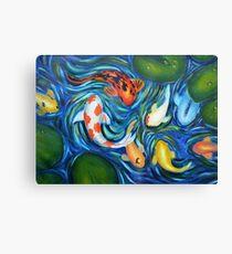 Koi circling in pond Canvas Print