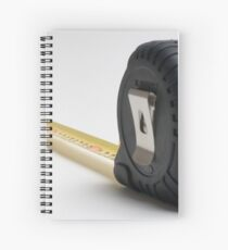 a yellow measuring tape on white background Spiral Notebook