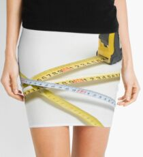 4 yellow and one unique white measuring tape on white background Mini Skirt
