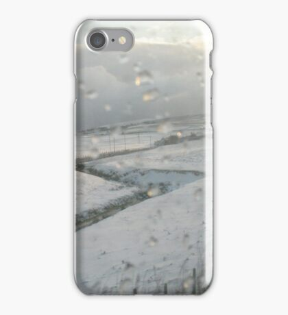 Slicing through the snowy landscape iPhone Case/Skin