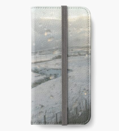Slicing through the snowy landscape iPhone Wallet
