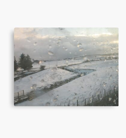 Slicing through the snowy landscape Canvas Print