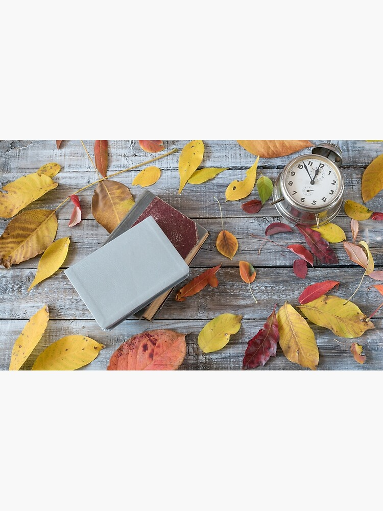Vntage books and clock on wooden table. Autumn composition. by JPopov