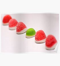 A line of red colourful sugared jelly sweets with one green one in the centre Poster