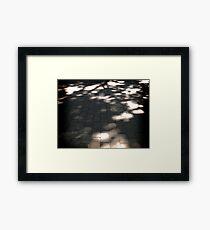 Sombras Framed Print