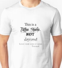 This is a Tattoo Studio.  NOT daycare! (for light colors & stickers) Slim Fit T-Shirt