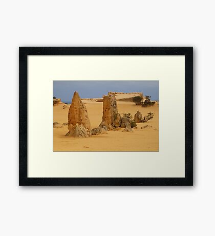 out of the sand Framed Print
