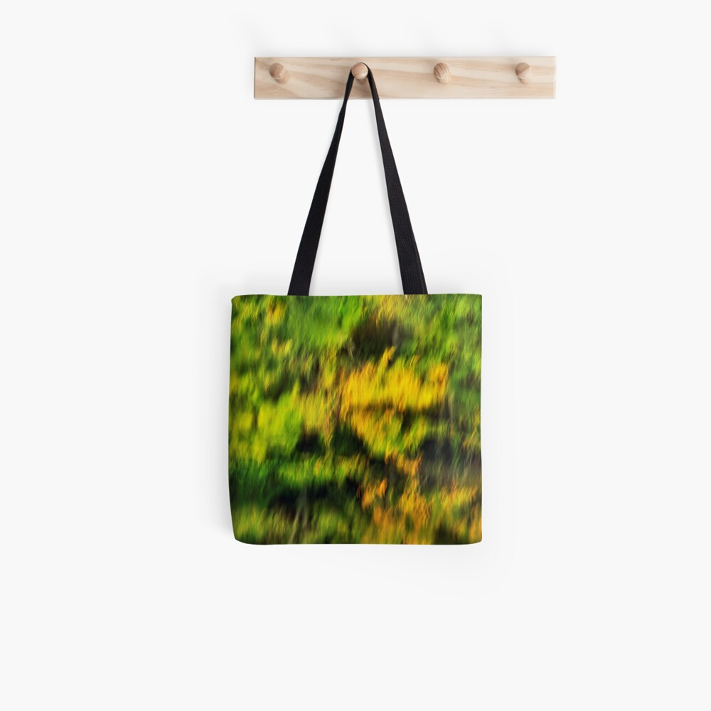 Abstract autumn colours reflected in the river Tote Bag