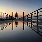 Lighthouse Reflections - Charlevoix Michigan  by Megan Noble