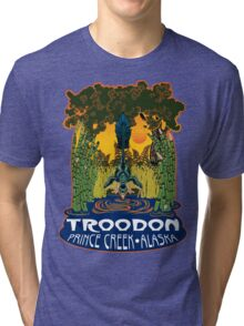 Retro Troodon in the Rushes (dark-colored shirt) Tri-blend T-Shirt