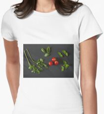 Green vegetables around three red tomatoes T-Shirt