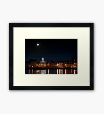 Building night lights and water reflection and moon Framed Print