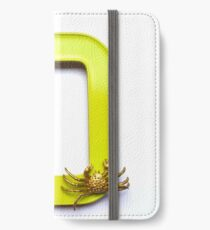 Blue butterfly and gold crab sit on a frame iPhone Wallet