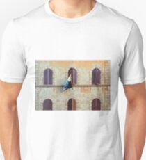 Italian building facade with arched windows with shutters and flag in Siena Unisex T-Shirt