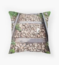 Rail track with metal sleepers and ballast stones. Throw Pillow