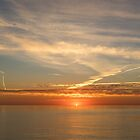 Painted by Airplanes - Contrails Streak the Sky at Sunrise by Georgia Mizuleva