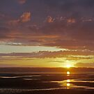 Sunset on sands. by Michael Haslam