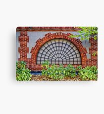 Covered by a grate Canvas Print