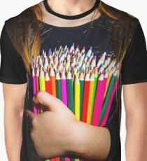 Cute little girl with colorful pencils, on yellow-green background Graphic T-Shirt