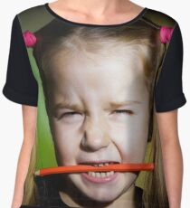 Cute little girl with colorful pencils, on yellow-green background Women's Chiffon Top