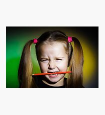 Cute little girl with colorful pencils, on yellow-green background Photographic Print