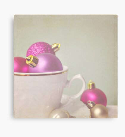 Pink and gold Christmas baubles in china cup Canvas Print