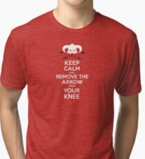 Keep calm and remove the arrow from your knee Tri-blend T-Shirt