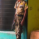 Standing Guard in Puerto Barrios Guatemala  by Heather Friedman