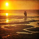 Couple on a sunset beach by Lyn  Randle