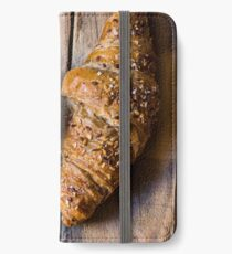 Whole wheat croissants with sesame seeds on rustic wood table top view iPhone Wallet/Case/Skin