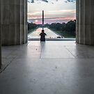 Sunrise watcher from atop the stairs of the Lincoln Memorial  by Sven Brogren