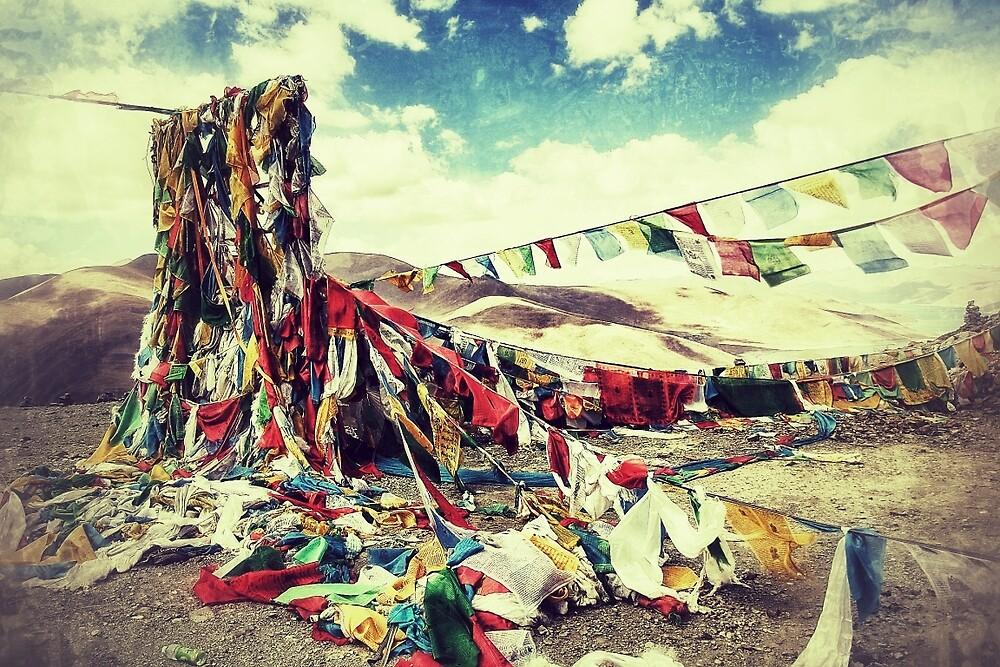 Prayer flags on a Tibetan peak by derek blackham
